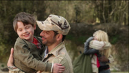 Stock Video Footage of Army soldier returning home to the embrace of his family