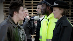 Angry demonstration in front of police line. Stock Footage