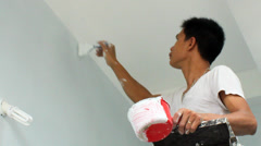 Asian man painting house - stock footage