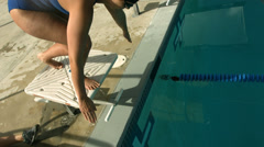 Swimmer diving into pool - stock footage