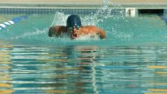 Swimmer doing freestyle stroke - stock footage