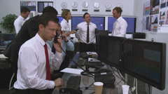 Financial business team of Stockbrokers trading. Could be large bank corporation - stock footage