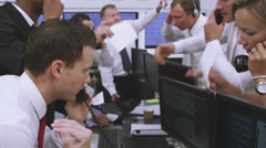 Financial business team of Stockbrokers or news reporters. Could be large bank Stock Footage