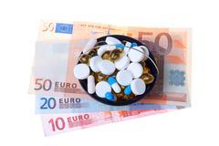 money and pills - stock photo