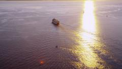Aerial shot of ferry crossing Puget Sound at sunset - stock footage