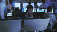 Stock Video Footage of Night staff working late into the evening. Security CCTV systems monitoring