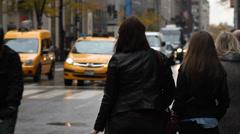 Woman hailing a cab, New York City, rain Stock Footage