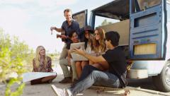 Group of young people on road trip - stock footage