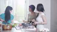 Stock Video Footage of Young people in the kitchen.Female friends cooking. Student house accommodation.