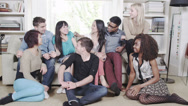 Stock Video Footage of Group of young people socialising together. Student house accommodation. Flat