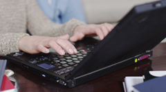 Young people working on laptop and digital technology - stock footage