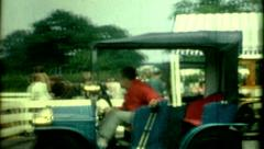 young kids driving old mini model t car united kingdom 1950s family fun lifestye - stock footage