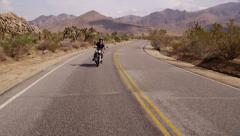 Young man driving motorcycle - stock footage