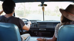 Young people on road trip driving van - stock footage