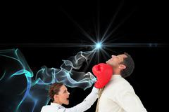 Composite image of businesswoman hitting a businessman with boxing gloves - stock illustration