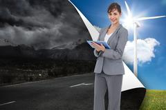Stock Illustration of Composite image of smiling businesswoman with tablet computer