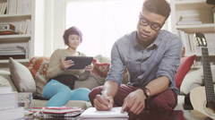 Young people working on laptop and digital technology. Student house - stock footage