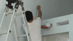Asian man painting house Stock Footage