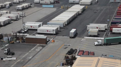 Trucks  at Port of Long Beach from on top of a container crane Stock Footage