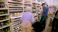 Supermarket checkout time lapse.  Consumers rushing through the market till with Stock Footage