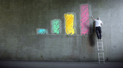 Graffiti artist expressing himself by drawing on the wall. Business Graph Stock Footage