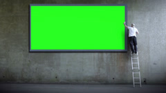 Billboard poster advertising.  Blank wall for copy space advertising.  Man Stock Footage