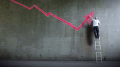 Graffiti artist expressing himself by drawing on the wall. Business Graph - stock footage