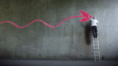 Graffiti artist expressing himself by drawing on the wall. Business arrow Graph Stock Footage