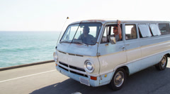 Group of young people on road trip driving van - stock footage