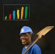 african american black man worker with chalk bar graph on a blackboard backgr - stock photo