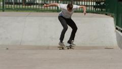 Skateboarder does trick at skatepark - stock footage
