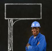 african american black man worker with a chalk road advertising sign - stock photo