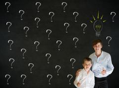 Thinking boy and businessman questioning ideas Stock Photos
