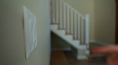 Hand touching the light switches Stock Footage