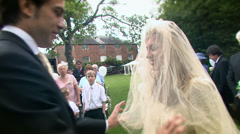 Wedding day - Bride and groom at the altar waiting to be married - stock footage