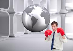 Composite image of businessman with his boxing gloves ready to fight Stock Illustration