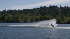 Water sprays behind skier, slow motion Stock Footage