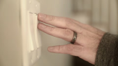 A hand using light switches Stock Footage