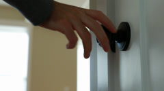 A hand opening a door knob Stock Footage