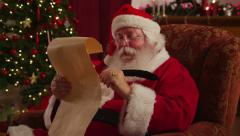 Santa Claus writes on list - stock footage