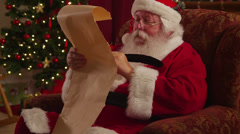 Santa Claus writes on list Stock Footage