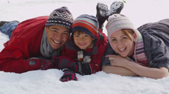 Portrait of family in winter snow Stock Footage