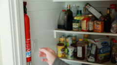 A man removes fire extinguisher Stock Footage