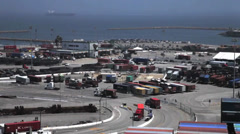 Trucks  at Port of Long Beach from on top of a container crane - stock footage