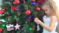 Stock Video Footage of Child Decorating Christmas Tree, Little Girl Playing Xmas Ball, Winter Holidays