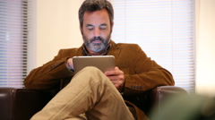 Man in hotel room using digital tablet - stock footage