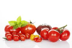 Stock Photo of tomatoes and basil isolated on white.