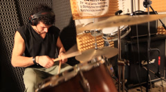 Rock drummer playing the drums at recording studio Stock Footage