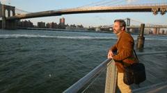 Man enjoying New York waterside view Stock Footage