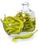 Pickled spicy green pepper Stock Photos